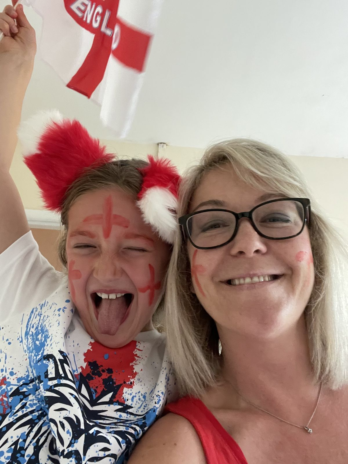 Nine-year-old Elsie Farrell gets behind England with mum Eve