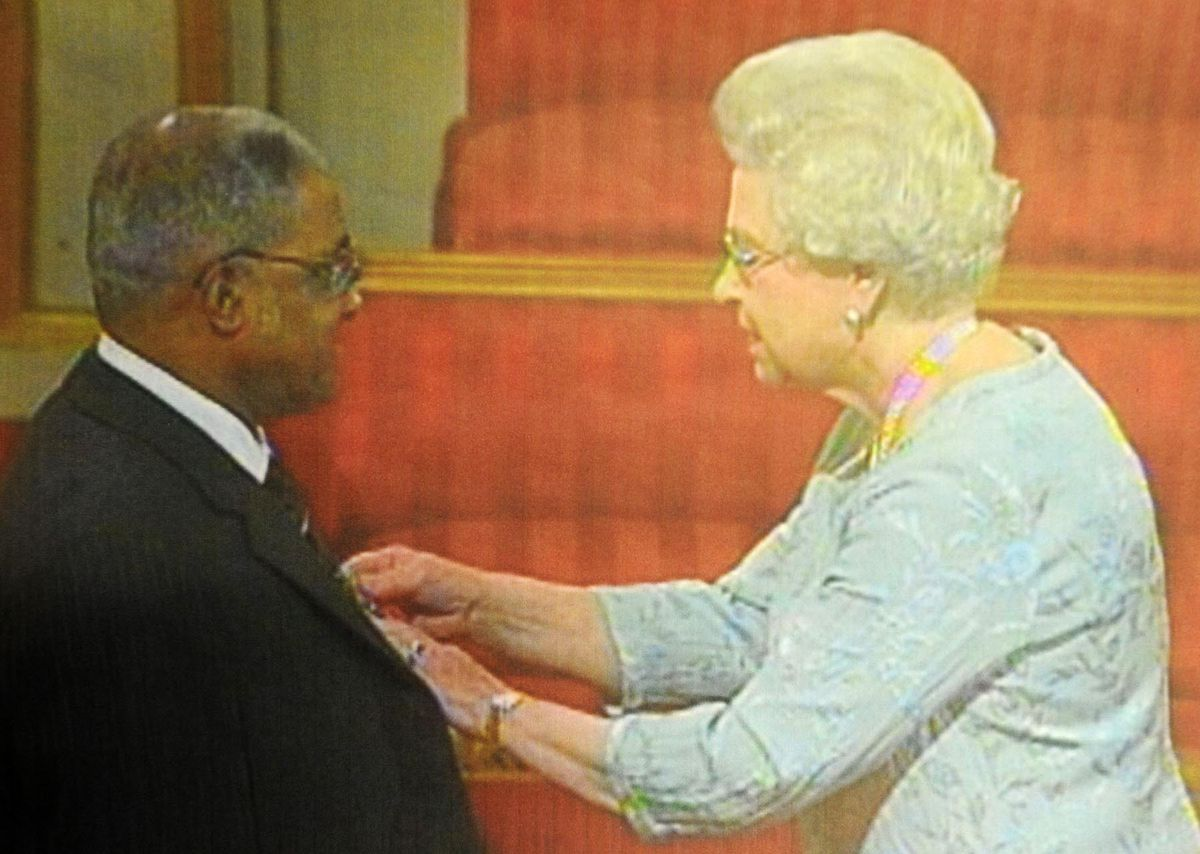 Bishop McCalla receives his MBE from the Queen