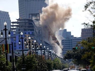 New Orleans sets off blasts to demolish cranes at collapsed hotel
