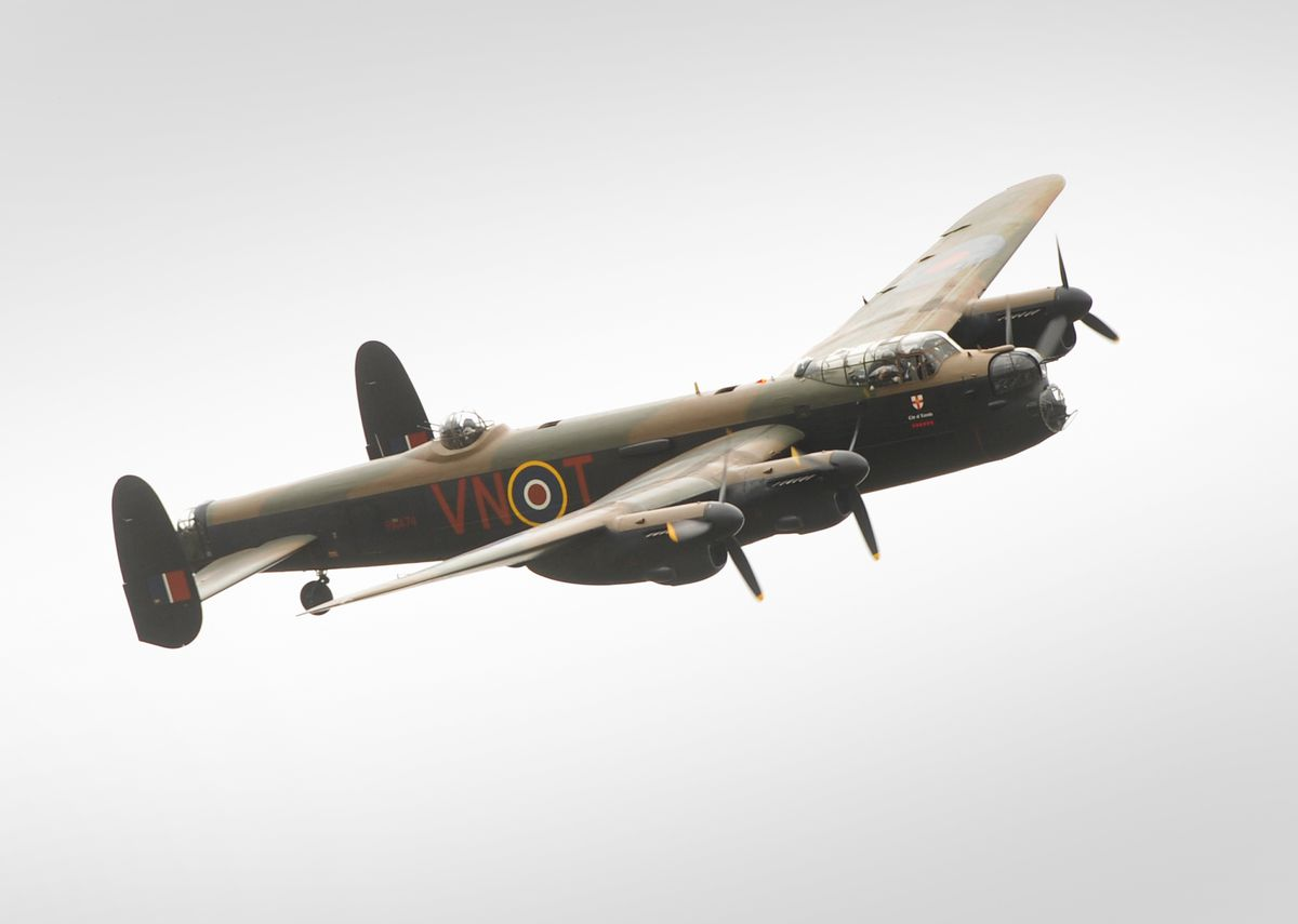 A Lancaster bomber flies past, during an event for veterans, at Wolverhampton Halfpenny Green Airport..