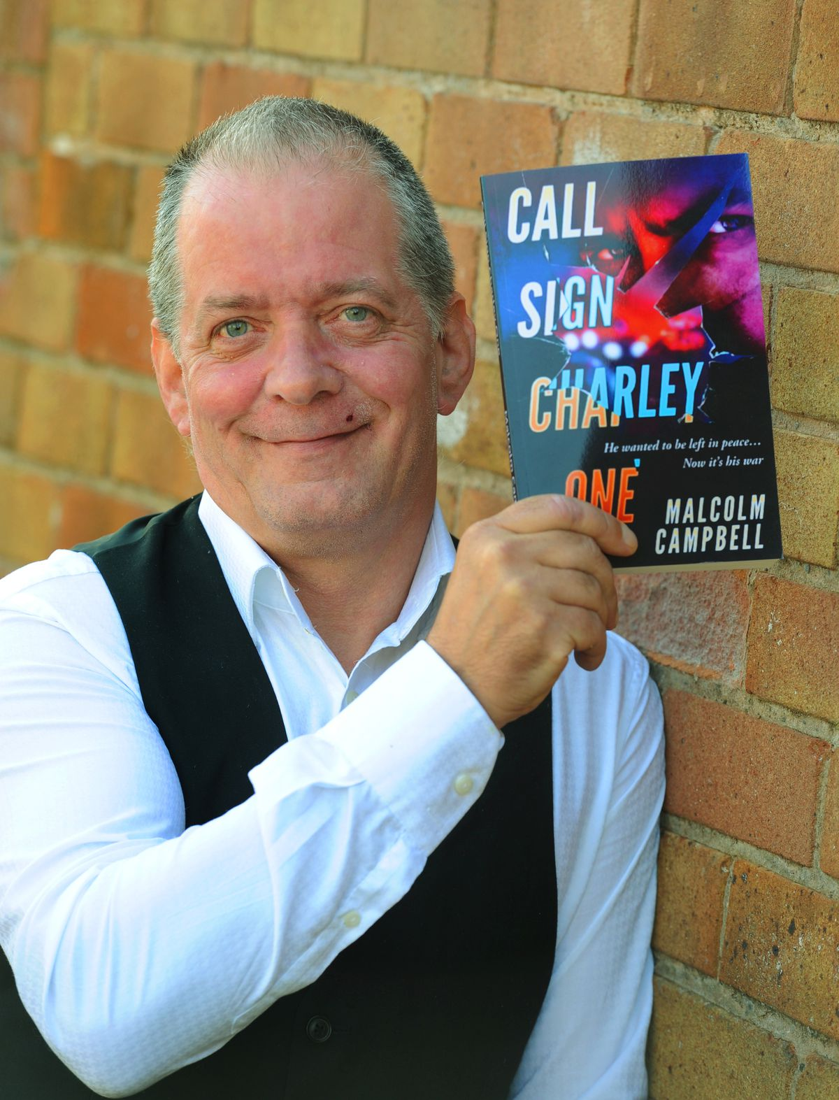 Author Malcolm Campbell, of Kidderminster, with his book 'Call Sign Charley One'