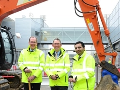 Minister marks start of airport's £30m extension