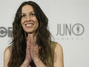Canadian singer Alanis Morisette celerates her Juno award, in Ottawa, April 6, 2003. Morisette won for Producer of the Year.      REUTERS/Jim Young