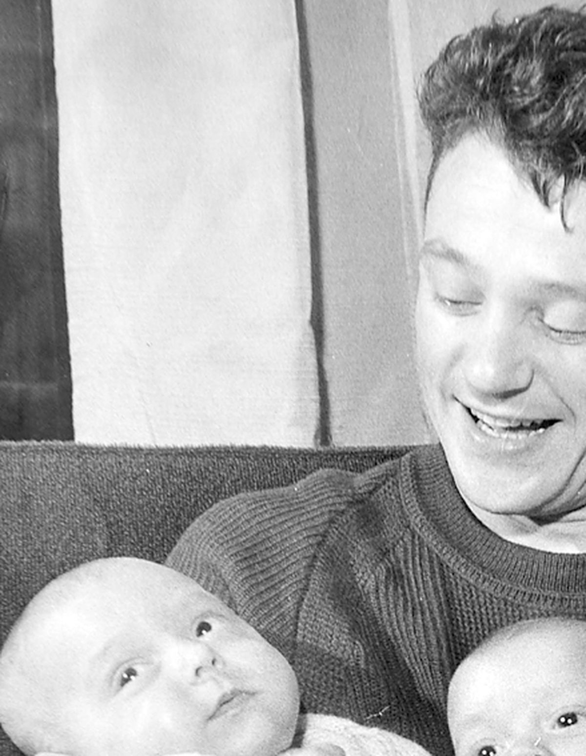 Andrew, Martin and Paul aged three weeks, with father Graham Tunney