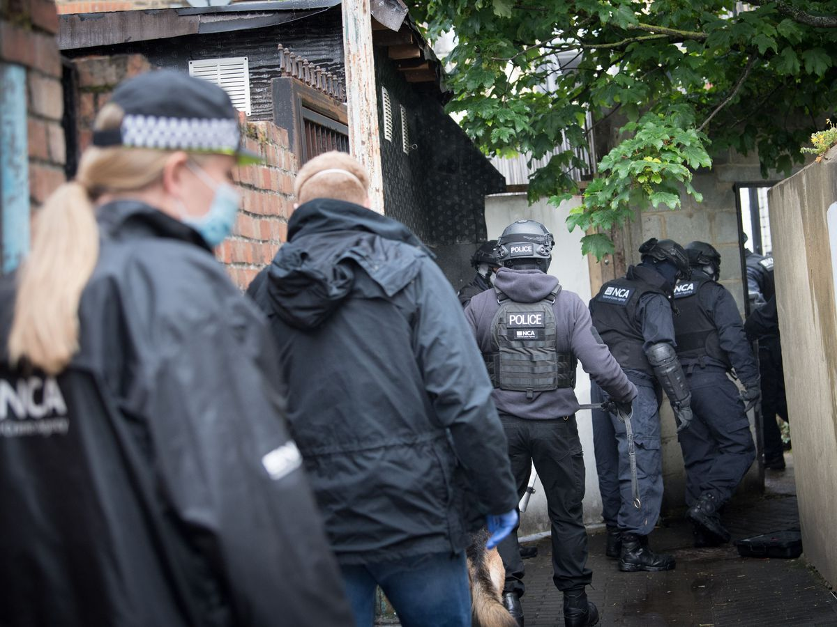 Police during a National Crime Agency operation in east London