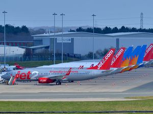SANDWELL COPYRIGHT EXPRESS AND STAR STEVE LEATH 29/03/2020..Pics at Birmingham Airport of quiet runway, planes parked up, including Flybe that collapsed, but apparently the goverment may take over. Plane stairs not being used etc etc and one of the control towers that looked empty inside..