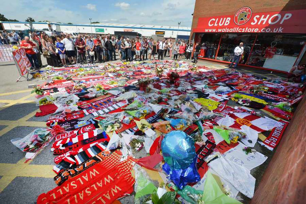 Scarfs and shirts laid in tribute at the Banks's
