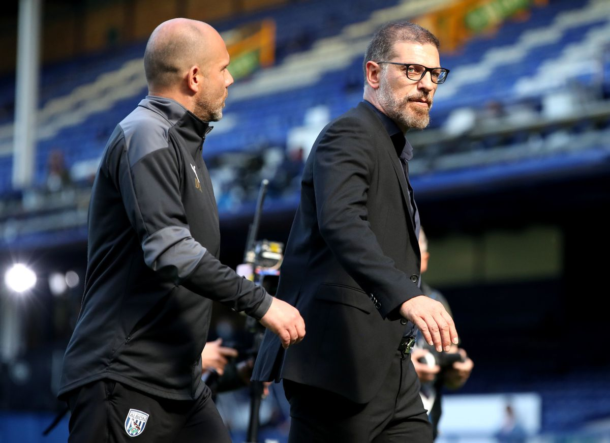 West Bromwich Albion manager Slaven Bilic (right) walks off the pitch after being shown a red card at half time