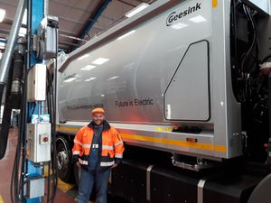 Councillor Oliver Butler with an electric bin lorry, which was trialled in Walsall.