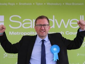 Scott Chapman celebrates his win for the Conservatives in Friar Park