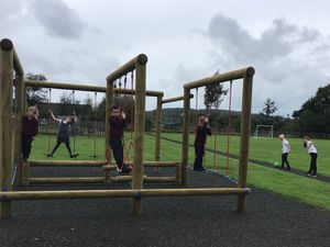 Pupils in Year Two on the new activity frame, while Year Five students test out the new running track