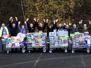 Former Goodyear workers, volunteers and deputy editor Diane Davies with the massive donation of food and toiletries at Blakemore Wholesale