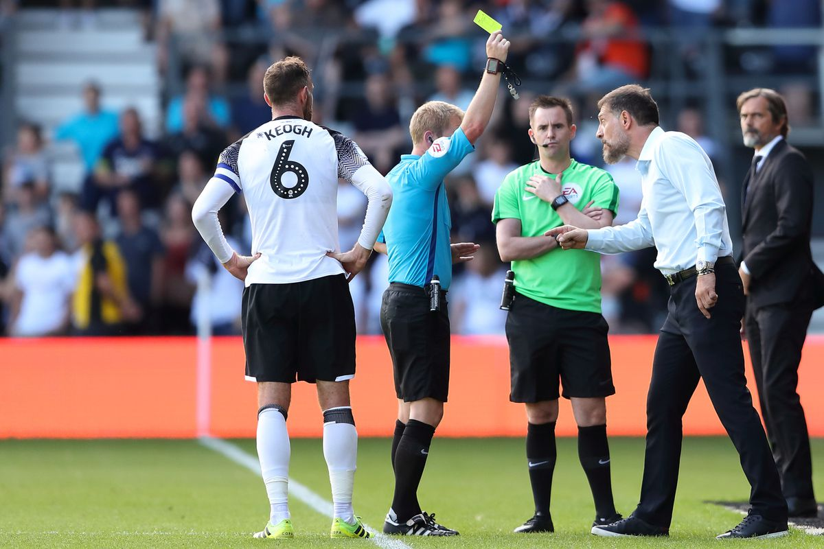 Slaven Bilic is shown a yellow card. (AMA)