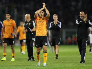 Conor Coady applauds the travelling fans at full-time (© AMA / Matthew Ashton)