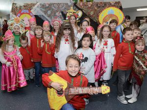 Nine-year-old Nikolai Haynes is pictured with other youngsters in traditional costumes ahead of their performance at the Maslenitsa celebrations