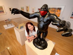 WOLVERHAMPTON COPYRIGHT EXPRESS&STAR TIM THURSFIELD 12/05/21.The Fantasy Pop exhibition at Wolverhampton Art Gallery. Marketing officer Laura Page next to maquette for King Kong, 1971, by Nicholas Monro...