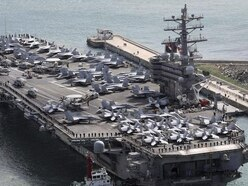 Aircraft with 11 aboard crashes into Pacific on way to US carrier