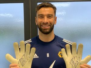 Goalkeeper Rui Patricio with the gloves he donated