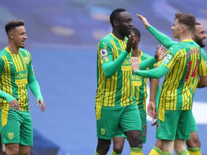Mbaye Diagne of West Bromwich Albion celebrates after he scores a goal to make it 1-4 with Conor Townsend of West Bromwich Albion.