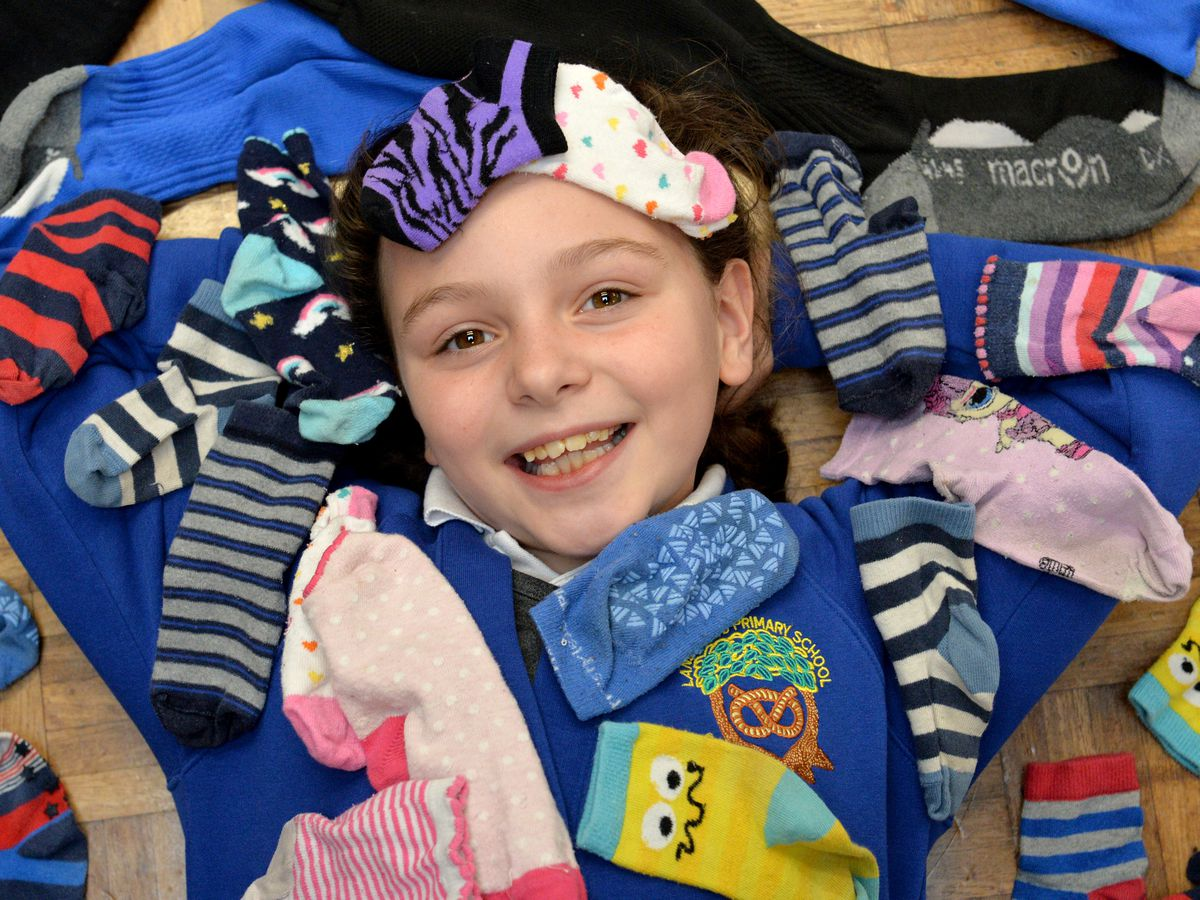 Pictured with odd socks is student Holly Shotton