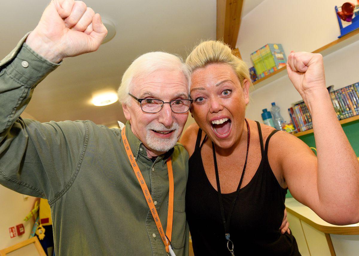 Volunteer Vic Shuck and healthcare assistant Katrina Vardarcik celebrate the news