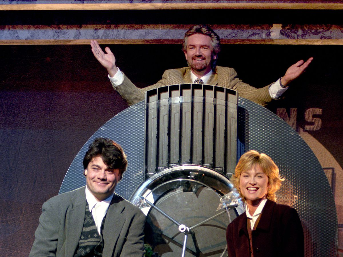Preparing for the first National Lottery draw were original presenters Gordon Kennedy, Noel Edmonds and Anthea Turner