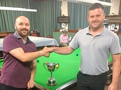 Dan Ward pockets the title spoils for a third time