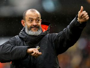 """Wolverhampton Wanderers manager Nuno Espirito Santo waves to the fans after his final game in charge at the end of the Premier League match at the Molineux Stadium, Wolverhampton. Picture date: Sunday May 23, 2021. PA Photo. See PA story SOCCER Wolves. Photo credit should read: Bradley Collyer/PA Wire.   RESTRICTIONS: EDITORIAL USE ONLY No use with unauthorised  audio, video, data, fixture lists, club/league logos or """"live"""" services. Online in-match use limited to 120 images, no video emulation. No use in betting, games or single club/league/player publications."""