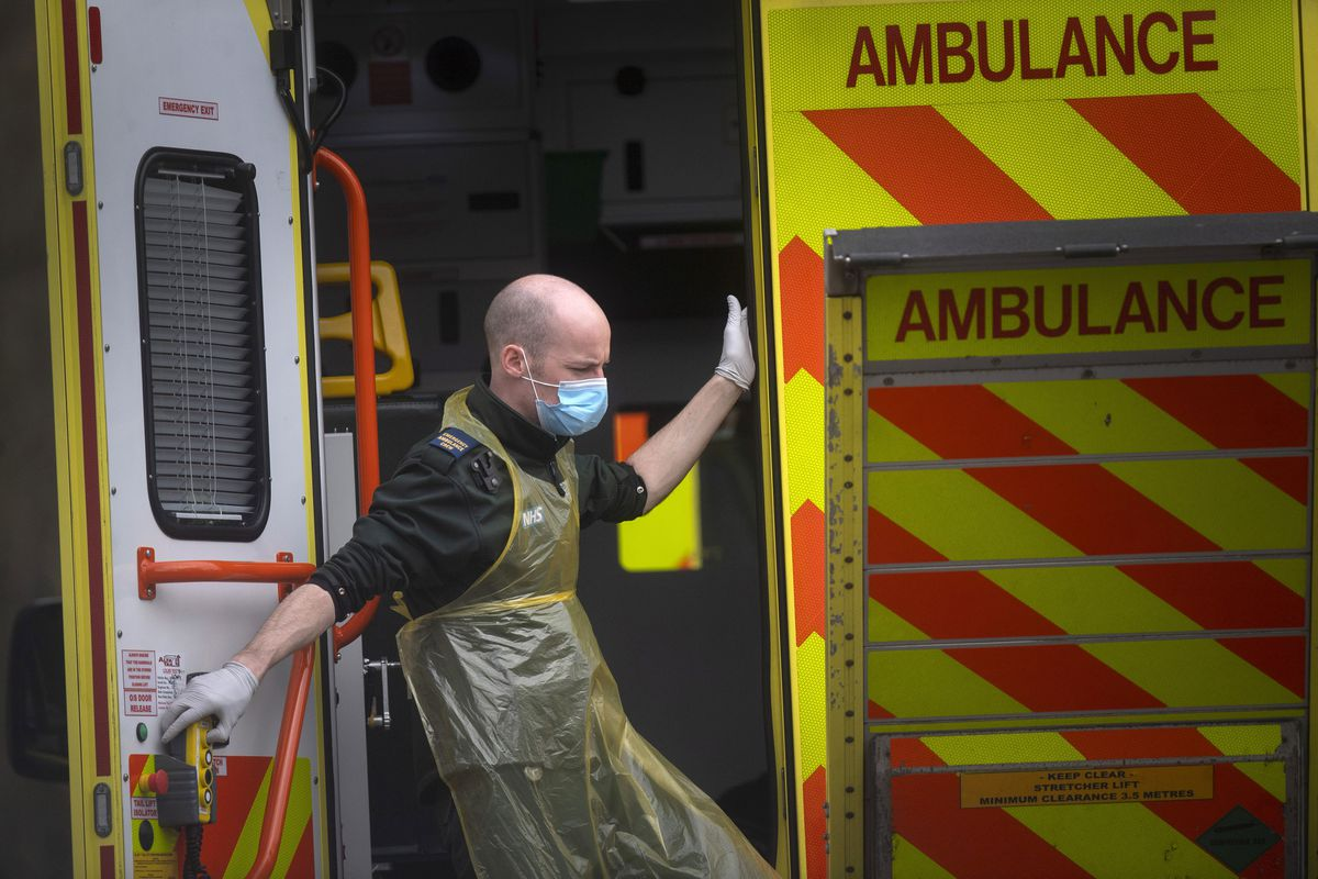 A London Ambulance worker wearing a protective face mask