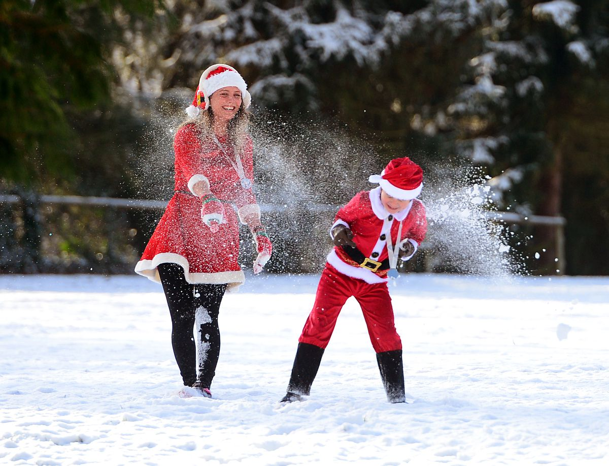 Hayley Andrews and son Jack, aged 8, play in the snow