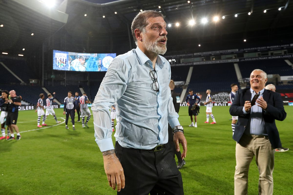 A champagne soaked Slaven Bilic head coach / manager of West Bromwich Albion as the team celebrate promotion to the Premier League on the pitch at the end of the match. (AMA)