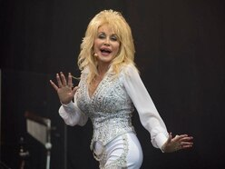Dolly Parton in tribute to 'sweet baby brother' Floyd after his death aged 61