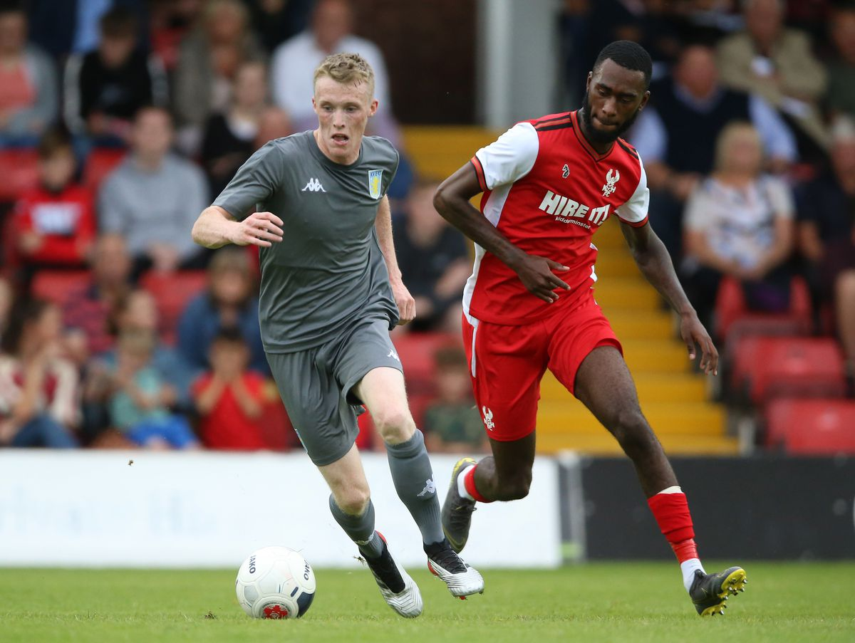 Kidderminster Harriers' Milan Butterfield (right) and Aston Villa's Jake Doyle Hayes battle for the ball during the pre-season friendly at Aggborough Stadium, Kidderminster