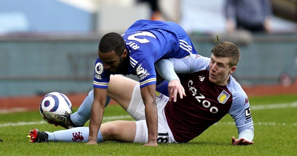 Leicester City's Ricardo Pereira (top) and Aston Villa's Matt Targett battle for the ball