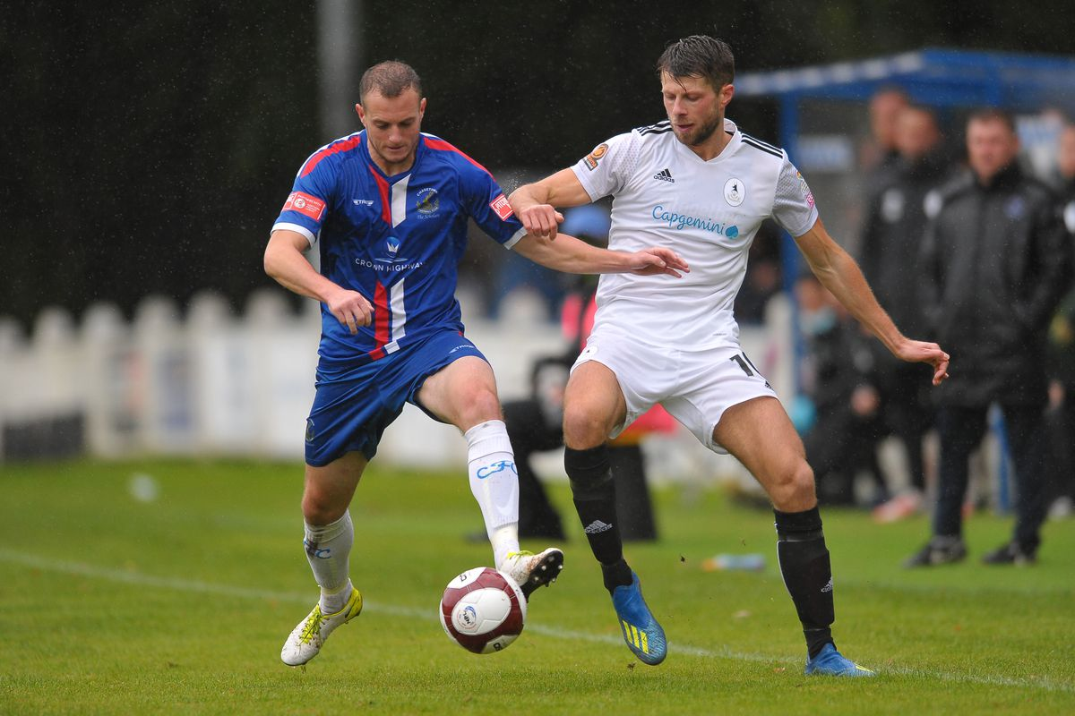 Jason Oswell battles for the ball during the FA Cup 2Q fixture