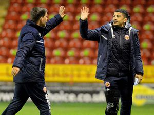 Darrell Clarke greets Josh Gordon who watched the 2-1 win over Leyton Orient on Tuesday with a brace on his right leg