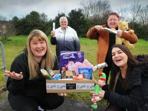 Appealing for donations to provide Christmas hampers, at Johns Lane, Great Wyrley, Helping Hearts organiser Zara Sands, with helpers David Washington, Helen Barnett and sponsor Amy Mitchell from Tincan Comms Ltd