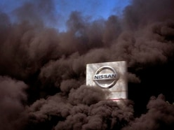 Nissan workers burn tyres at gate of Barcelona factory after closure announced