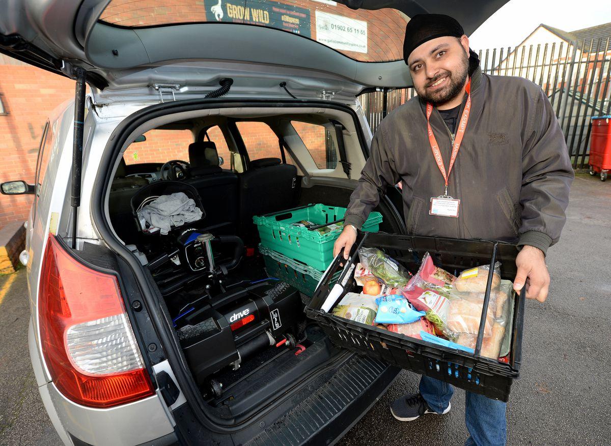 Volunteer Savino Kandola loading some of the food boxes