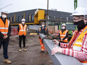 Councillor Louise Miles, front, signs one of the phase two steels with, from left, Ion associate director Chris Jones, Galliford Try's Jonathan Martin, senior site manager Phil Hayes and business development/CSR manager Dawn Jevons