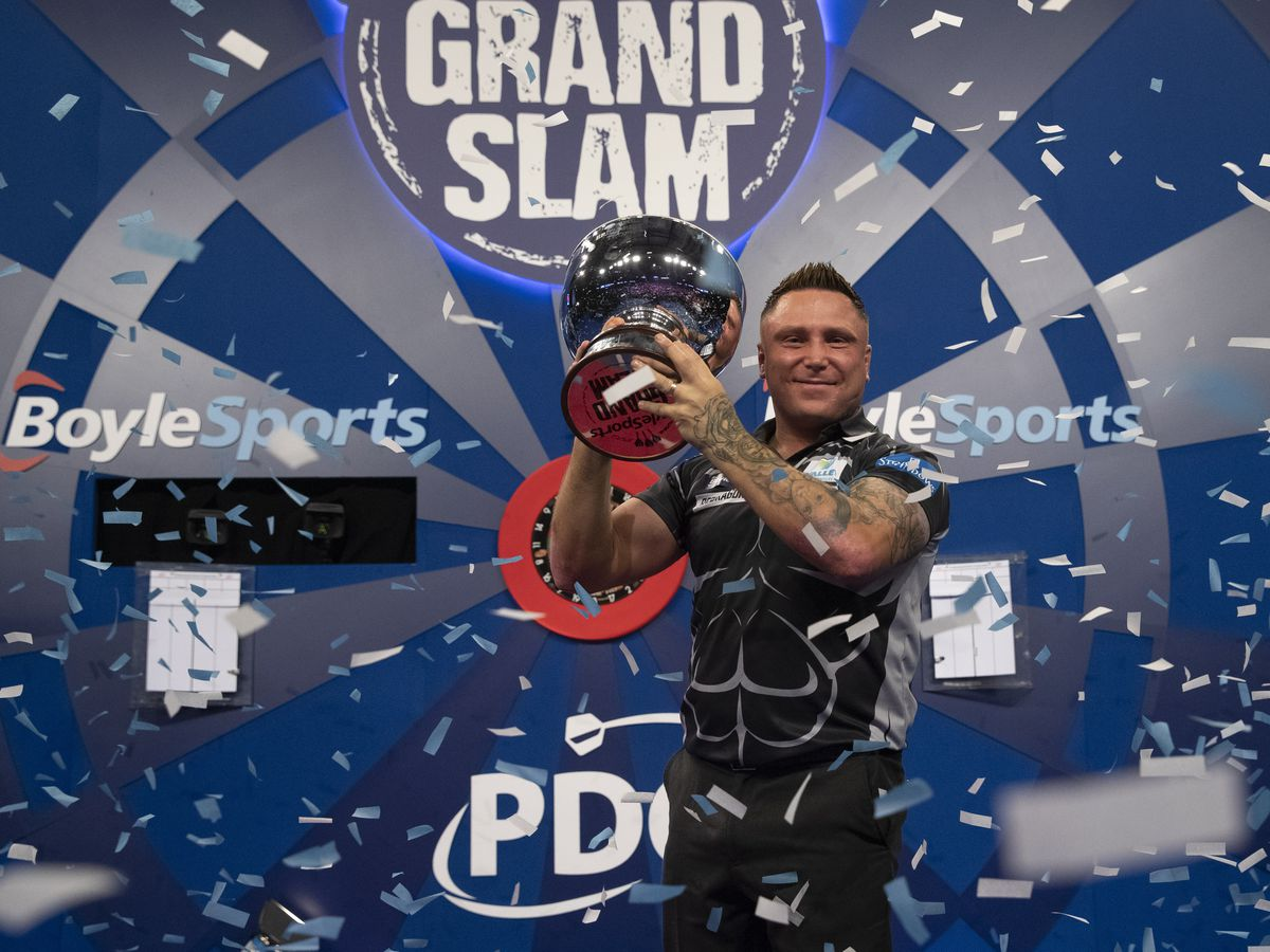 Gerwyn Price celebrates retaining his Grand Slam of Darts title (Picture: Lawrence Lustig)