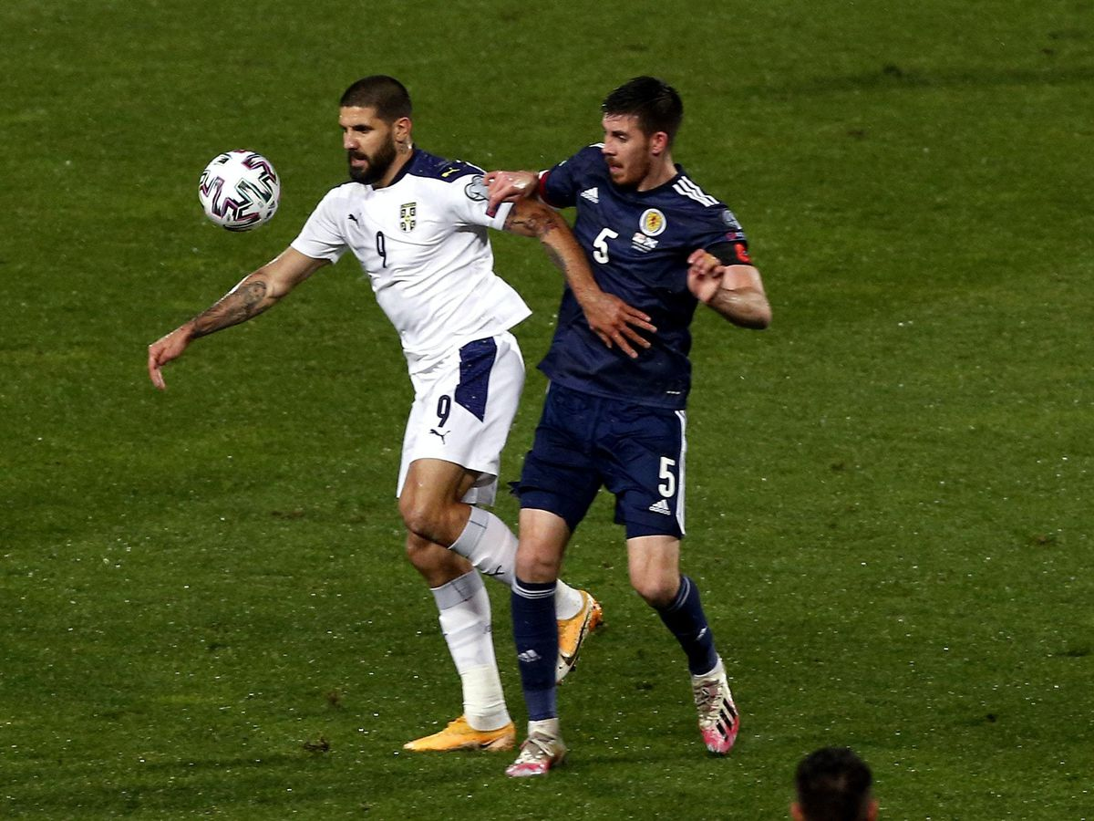 Declan Gallagher, right, shackled Serbia's Aleksandar Mitrovic but suffered his first Scotland loss in Israel