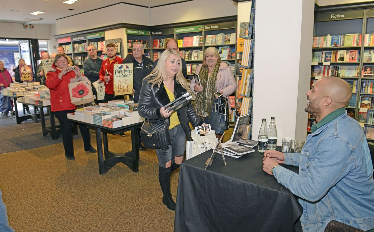 Fans queue up as former Wolves Keeper Carl Ikeme signs copies of his new book 'Why Not Me' at Waterstones in Wolverhampton
