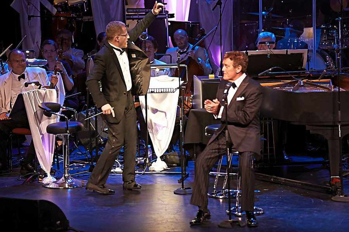 Adrian Jackson conducting A Touch of Vegas with the late Alvin Stardust