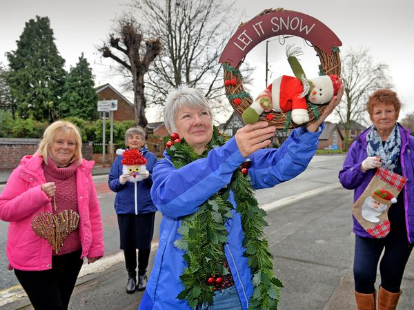 Gillian Howells, Pat Lakham, Bev Vine and Val Sweet get ready to put up the decorations