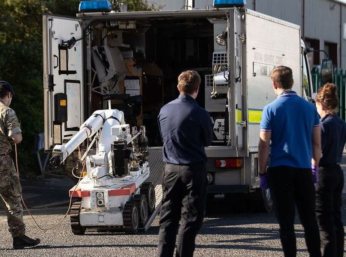The bomb disposal team arrives on School Street in Wednesbury to disable the device