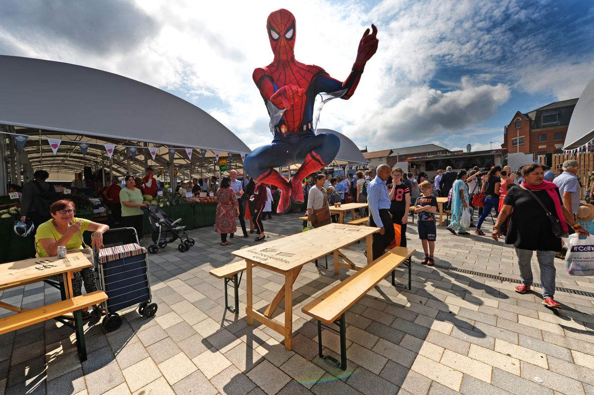 Wolverhampton Market, Cleveland Street Official launch of the new market. Pictured , Spider Man swings in to visit the new market..