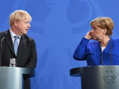 Johnson tells Merkel Brexit deal is possible if backstop scrapped