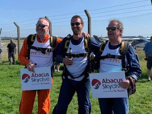Financial advisers Daniel Paton and Ben Dyas with MD Nigel Round after the skydive