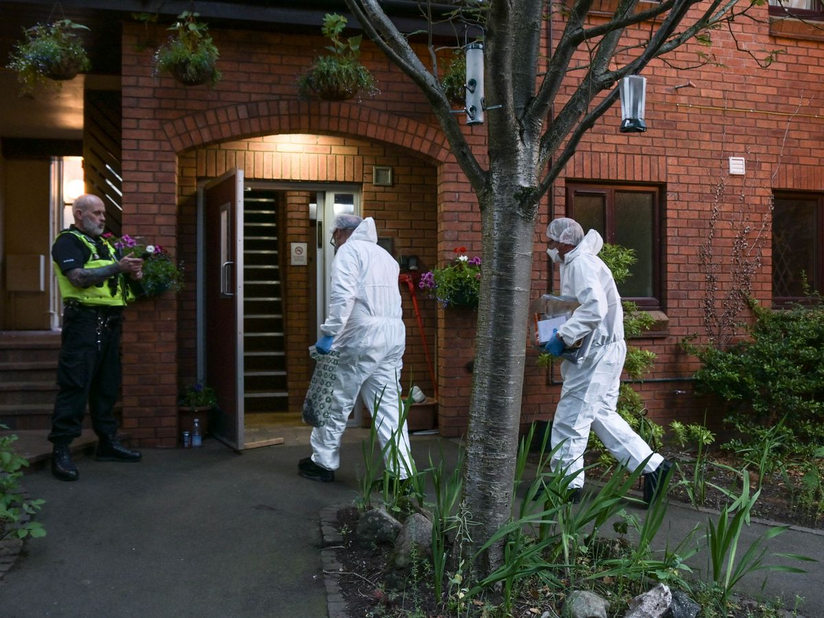 Forensics officers at the flat in Wolverhampton. Photo: SnapperSK